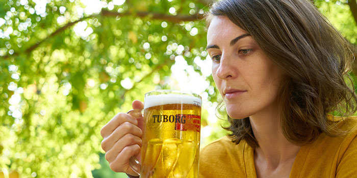 woman looking at the glass of beer