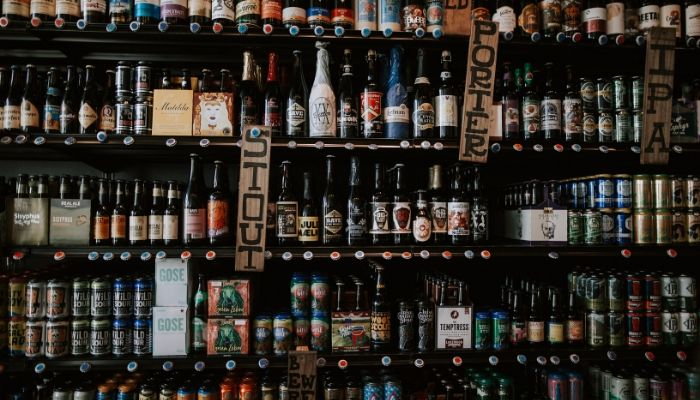 Beer bottles and cans on the shelf